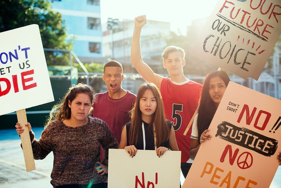 bigstock-Group-of-teenagers-protesting--283641958